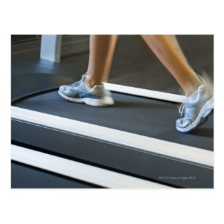 Low section of woman walking on treadmill 2 postcard