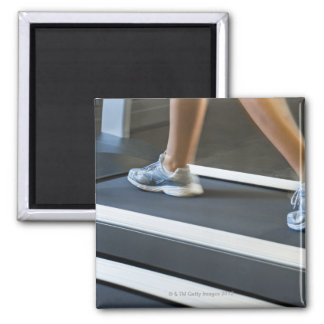 Low section of woman walking on treadmill 2 square magnet