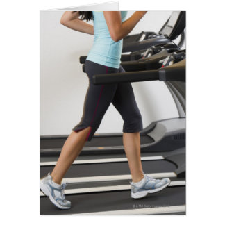Low section of woman walking on treadmill card