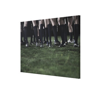 Lower section of a group of rugby players canvas print
