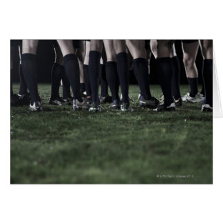Lower section of a group of rugby players card