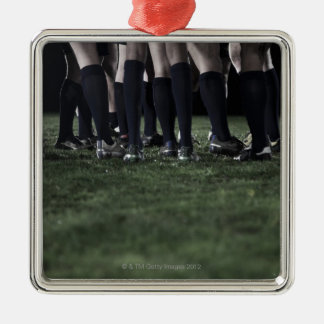 Lower section of a group of rugby players christmas ornament