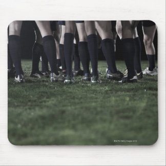 Lower section of a group of rugby players mouse pad