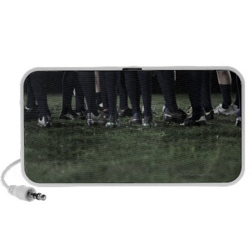 Lower section of a group of rugby players laptop speaker
