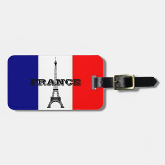 Luggage tags with flag of France and Eiffel tower.