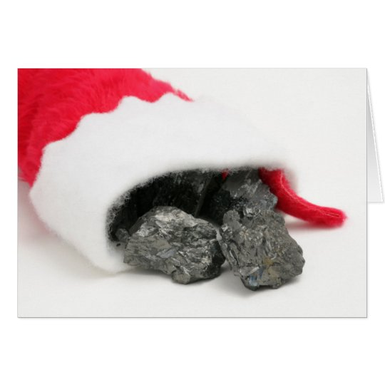 Lumps of coal spilling out of a Christmas