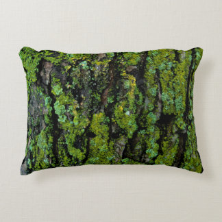 Lush, green, and mossy tree trunk decorative cushion