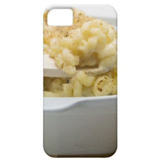Macaroni cheese in baking dish with wooden iPhone 5 case