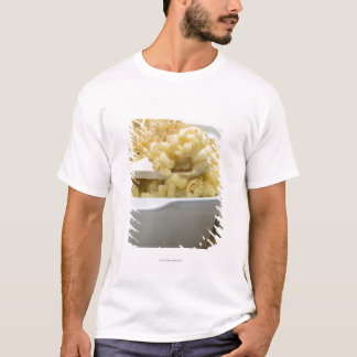 Macaroni cheese in baking dish with wooden T-Shirt