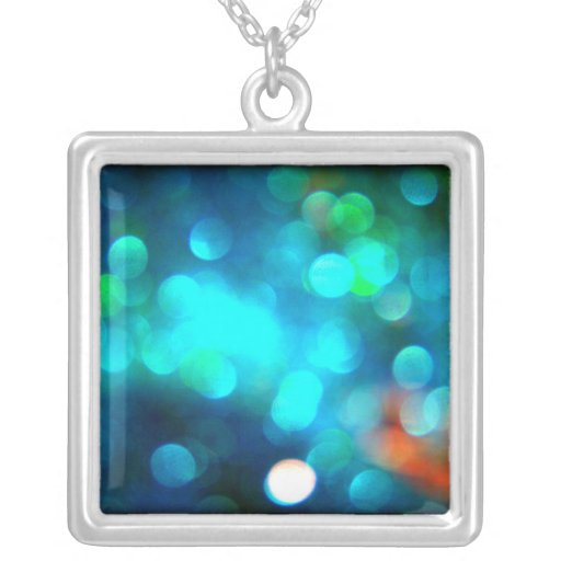 Macro bokeh glitter turquoise blue photo necklace