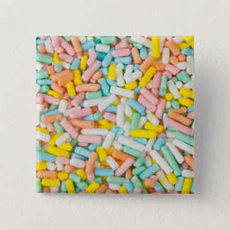 Macro image of a small scoop of pastel-colored 15 cm square badge