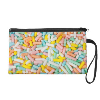 Macro image of a small scoop of pastel-colored wristlet clutch