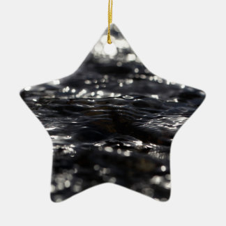 Macro photo of the surface of water in a creek ceramic star decoration