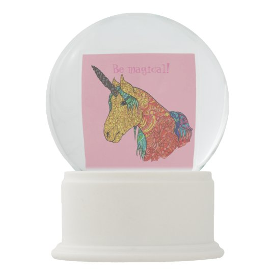 Magical rainbow unicorn snow globe