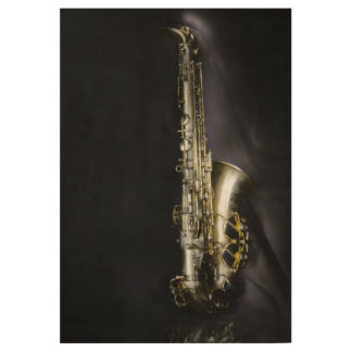 Magnificent brass saxophone on black background wood poster