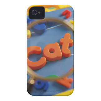 Magnifying glass enlarging view of word CAT Case-Mate iPhone 4 Cases
