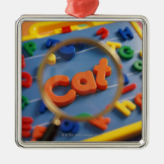 Magnifying glass enlarging view of word CAT Silver-Colored Square Decoration