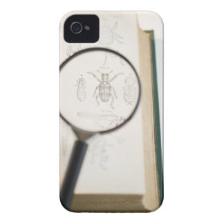 Magnifying glass over book showing insects iPhone 4 covers