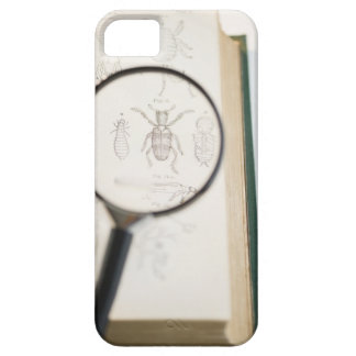 Magnifying glass over book showing insects iPhone 5 case