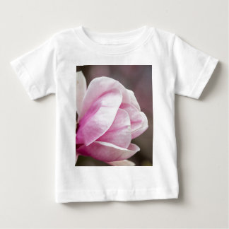 magnolia blooming  on tree baby T-Shirt