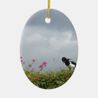 Magpie and wild flowers. ceramic oval decoration