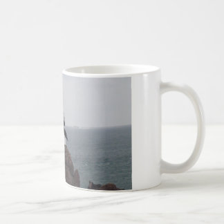 Magpie flying past La Corbiere Lighthouse Coffee Mug