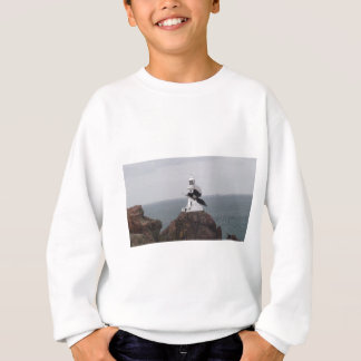 Magpie flying past La Corbiere Lighthouse Sweatshirt