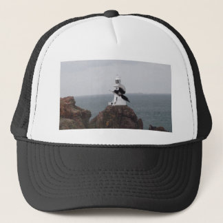 Magpie flying past La Corbiere Lighthouse Trucker Hat