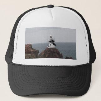 Magpie flying past La Corbiere Lighthouse Trucker Hat