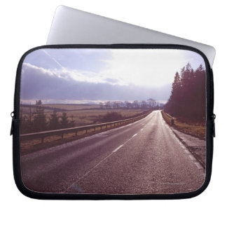 Main road with low winter sun. laptop computer sleeves