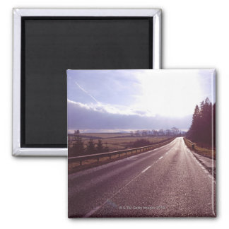 Main road with low winter sun. square magnet