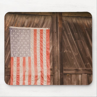 Maine, Faded American flag on door of old barn Mouse Mat