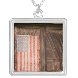 Maine, Faded American flag on door of old barn Silver Plated Necklace