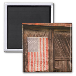 Maine, Faded American flag on door of old barn Square Magnet