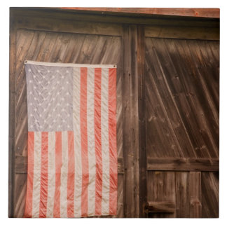 Maine, Faded American flag on door of old barn Tile