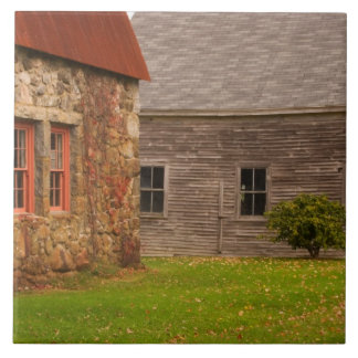 Maine,  Old stone building and wooden barn in Tile