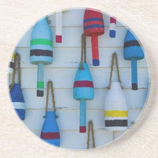 Maine, Stonington, decorative lobster buoys Coaster