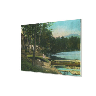 MaineView of a Woman on a Canoe by the Shore Canvas Print