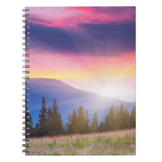 Majestic mountains landscape under morning sky spiral note book