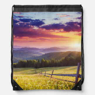 Majestic sunset in the mountains drawstring bag