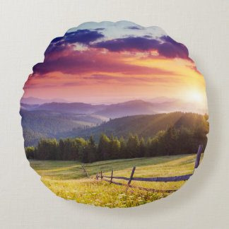 Majestic sunset in the mountains round cushion