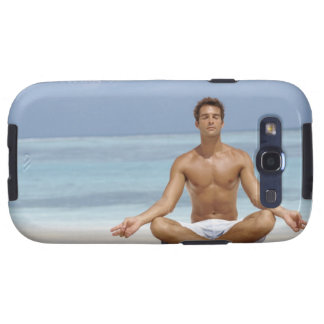 Maldives, Handsome young man meditating in a Galaxy SIII Case