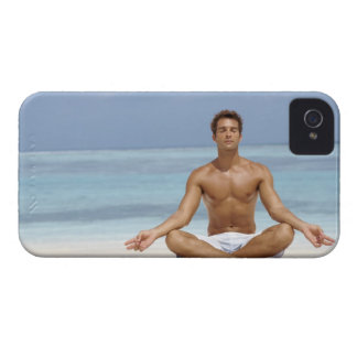 Maldives, Handsome young man meditating in a Case-Mate iPhone 4 Cases