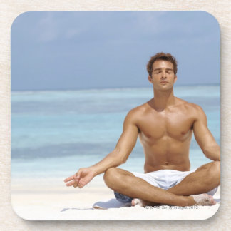 Maldives, Handsome young man meditating in a Coaster