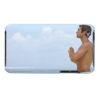 Maldives, Smart young guy practicing yoga at iPod Touch Cases