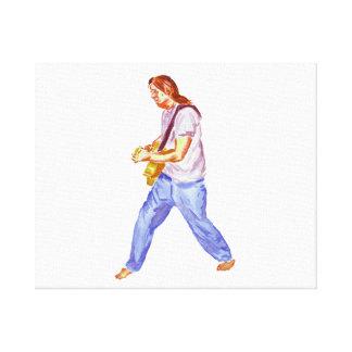 Male acoustic guitar player jeans feet apart canvas print