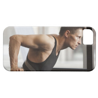 Male athlete using gymnastics equipment in gym case for the iPhone 5