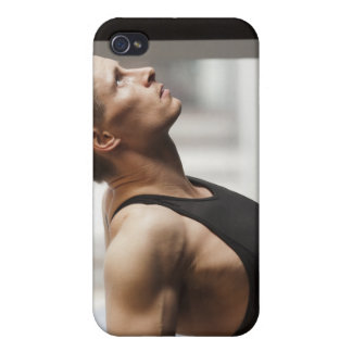 Male athlete using gymnastics equipment in gym iPhone 4 cases