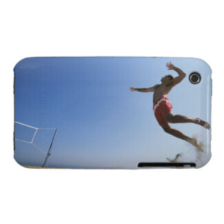 Male beach volleyball player jumping up to spike iPhone 3 case