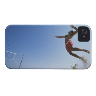 Male beach volleyball player jumping up to spike iPhone 4 Case-Mate cases